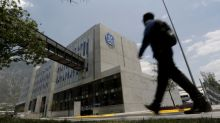 GE vows $20 bln asset sales, 'sweeping change' as profit falls