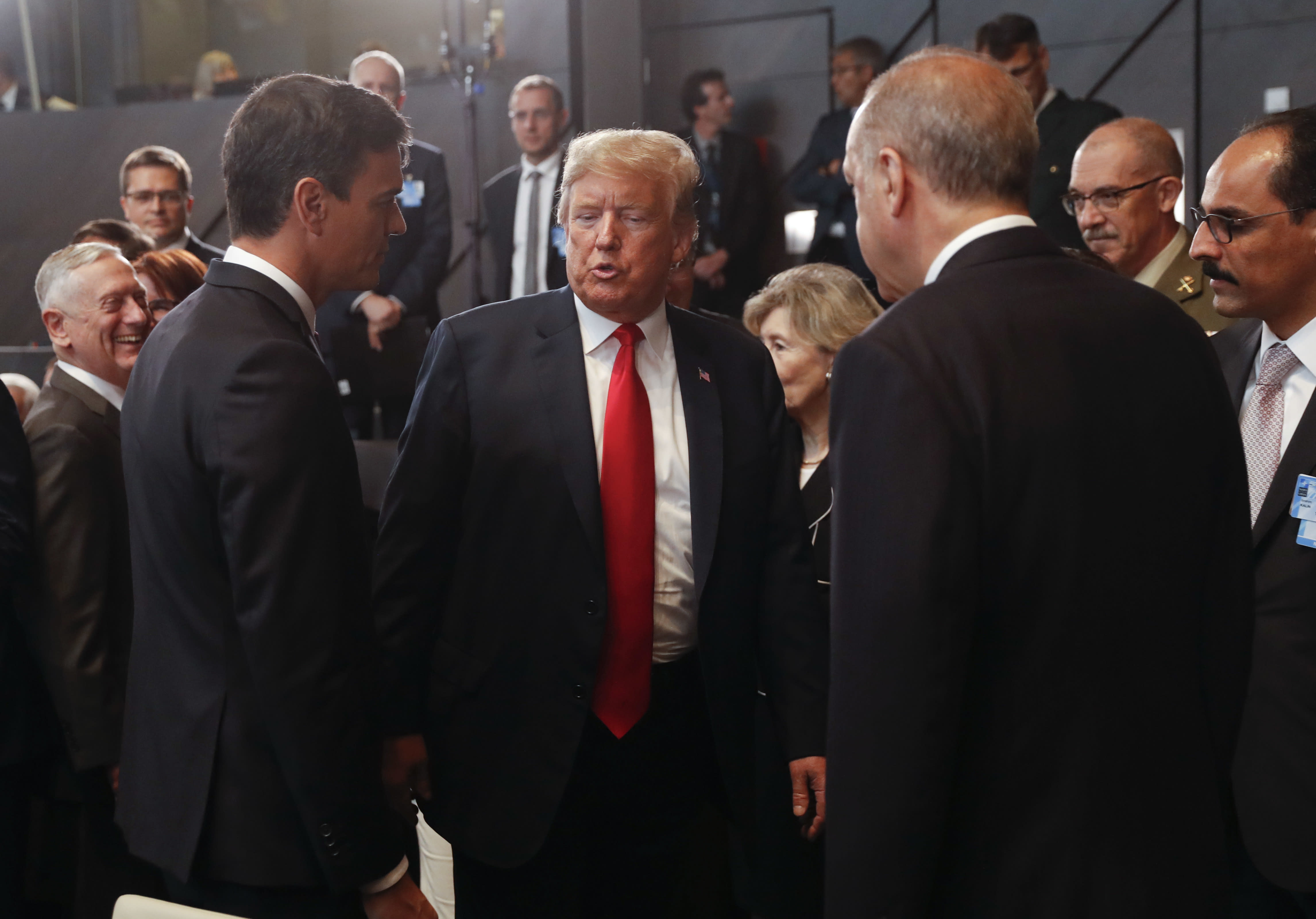 No shove, but Trump body language speaks to frosty relations