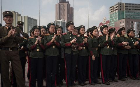"""As North Korean dictator Kim Jong-un boasts of his military prowess and flaunts his high tech weapons to the world, his malnourished soldiers are said to be stealing corn from fields to stave off hunger pangs. Officers are ordering their troops to supplement their meagre food rations by plundering local fields, in order to keep up their strength for battle, according to a report in the Daily NK. """"The military officers are instructing their soldiers, exhausted after training, to eat corn in the fields because war is imminent,"""" a source in North Hamgyong Province told the news website. Inside North Korea """"They are even threatening their soldiers, saying: if you become malnourished despite permission to eat the corn, you will face difficulties."""" Another source in Ryanggang Province claimed that soldiers carrying big sacks of unripened corn had frequently been spotted trying to sell their wares at markets. The desperate conditions of his army paints a stark contrast with Mr Kim's brash threats since he fired a ballistic missile over Japan on Tuesday. North Korean leader Kim Jong-un presides over a target strike exercise conducted by the special operation forces of the Korean People's Army Credit: AFP On Wednesday he hailed the test as a """"good experience in…rocket operation for an actual war"""" and as a """"meaningful prelude to containing"""" Guam, the US Pacific territory he threatened with missile strikes earlier this month. North Korean citizens, some of whom now have to guard their fields from marauding troops, are reported to be unimpressed by his bravado. """"An increasing number of residents are pointing out that, for them, provoking the US is a losing battle,"""" the Daily NK reported. Korean People's Army (KPA) soldiers applaud as they watch a screen showing the missile test launch, in Pyongyang Credit: AFP"""