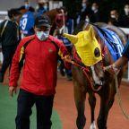 Virus-hit Hong Kong racing gallops on behind closed doors