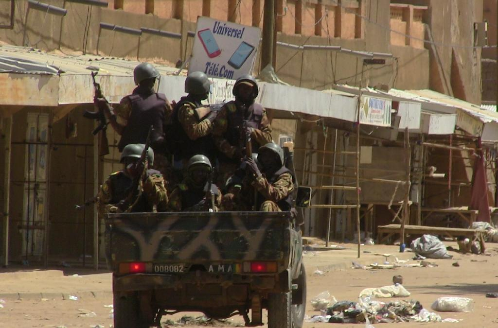 Since the overthrow of Moamer Kadhafi's regime in Libya, weapons have travelled freely from the chaotic state in an arc of unrest through Mali and Niger (AFP Photo/SOULEYMANE AG ANARA)