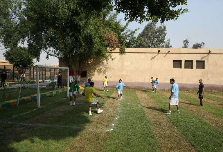 During a guided tour for the media, prisoners play football in the Egyptian capital's Tora prison (AFP Photo/Mohamed el-Shahed)