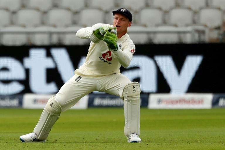 Keep up - England's Jos Buttler had a tough time behind the stumps in the first Test against Pakistan