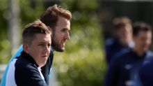 Injured Harry Kane watches on as England squad train at Tottenham