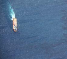 China spots four oil slicks from sunken tanker