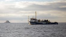 Boat with migrants rescued off Libya looks for port to dock