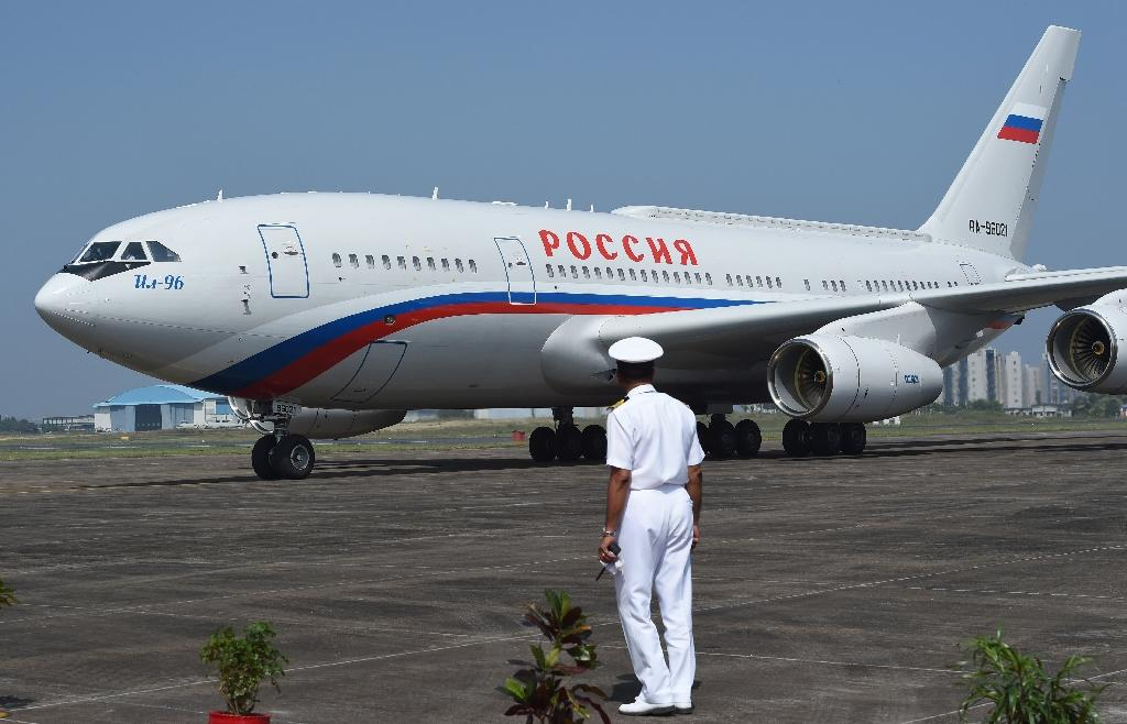 An Indian Navy officer stands as Russian President Vladimir Putin's aircraft arrives at the airport in Goa on October 15, 2016 (AFP Photo/Money Sharma)