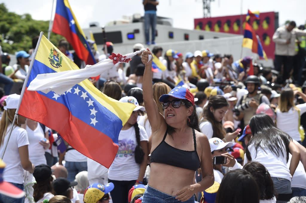 Demonstrators blame Venezuelan President Nicolas Maduro for the country's plight and a shortage of food and medicine (AFP Photo/JUAN BARRETO )