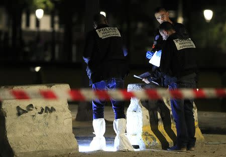 Police investigators work on the scene after seven people were wounded in knife attack downtown Paris, France, September 10, 2018. REUTERS/Gonzalo Fuentes