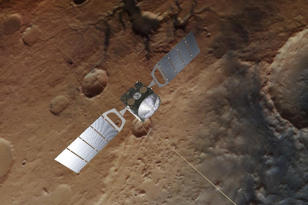 A photograph obtained from the European Space Agency shows an artist's impression of Mars Express over a background based on an actual image of the Red Planet taken by the spacecraft (AFP Photo/Handout)