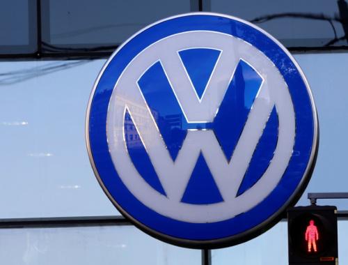 The logo of German car maker Volkswagen is seen outside a garage in Vienna