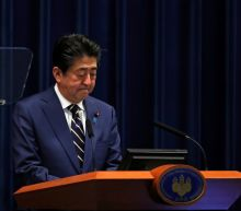 Japan's Abe vows unprecedented stimulus, Tokyo virus cases rise by daily record