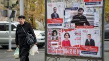 Armenian PM wins snap vote by landslide