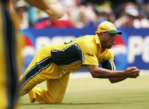 Andrew Symonds of Australia dives to catch a ball from Mohammad Kaif of India