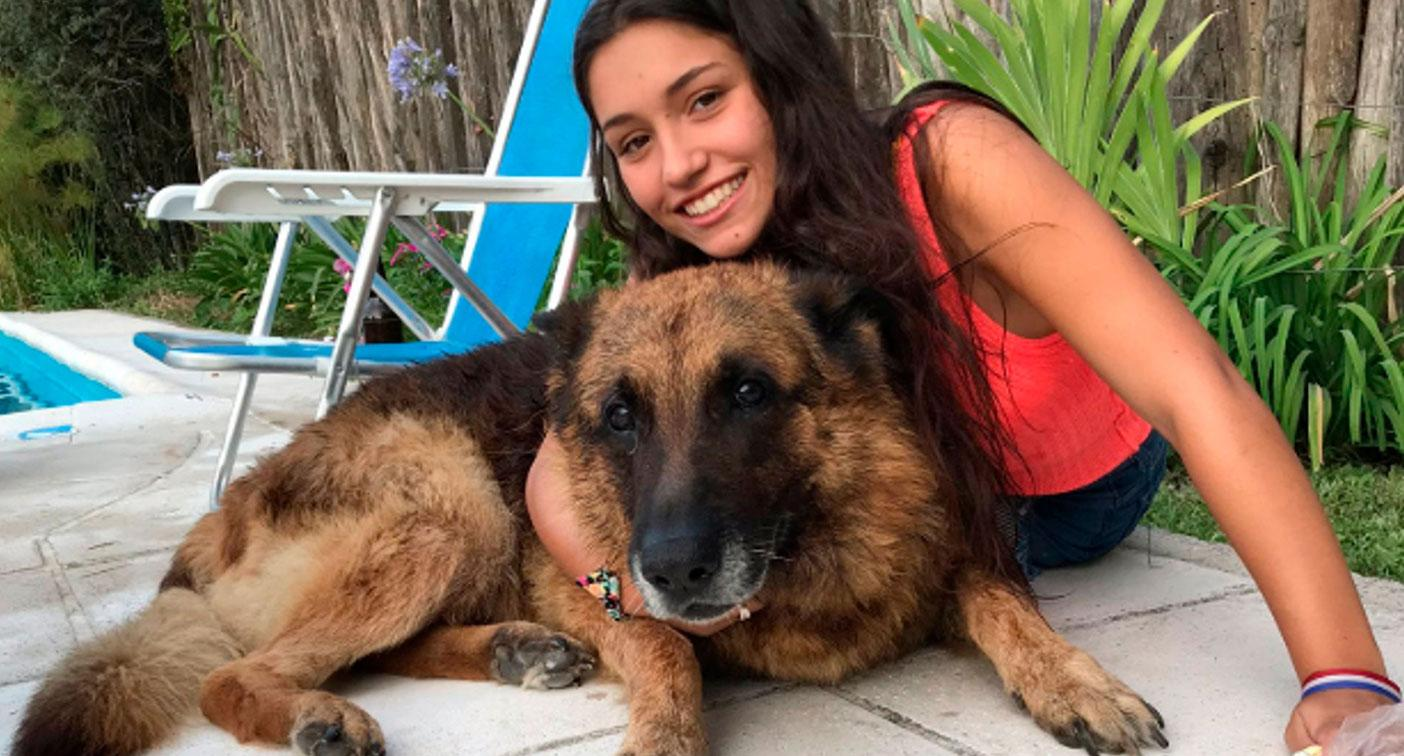 Teen girl's happy snap with dog goes horribly wrong