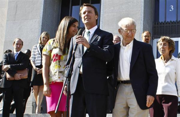 Former U.S. Senator John Edwards (C) makes a statement with his daughter, Cate Edwards, father Wallace Edwards (2nd R), and mother Bobbie Edwards (R) as defense attorney Abbe Lowell (L) looks on after the jury reached a verdict at the federal courthouse in Greensboro, North Carolina May 31, 2012. Jurors acquitted former U.S. Senator John Edwards on one count of taking illegal campaign contributions on Thursday and the judge declared a mistrial on five other counts because the jury was deadlocked.