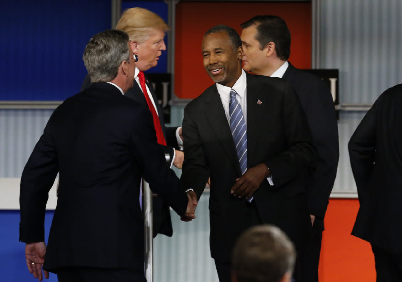 <p>Republican presidential candidates (L-R) former Florida Gov. Jeb Bush, businessman Donald Trump, Dr. Ben Carson and Sen. Ted Cruz shake hands at the conclusion of the debate held by Fox Business Network for the top 2016 U.S. Republican presidential candidates in Milwaukee. (Photo: Jim Young/Reuters)</p>