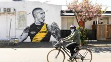 Prowling our living rooms: the reality of AFL grand final day in locked-down Melbourne