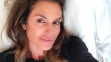After back-to-back Halloween bashes, Cindy Crawford goes makeup-free for a selfie in bed: 'Recovery mode'