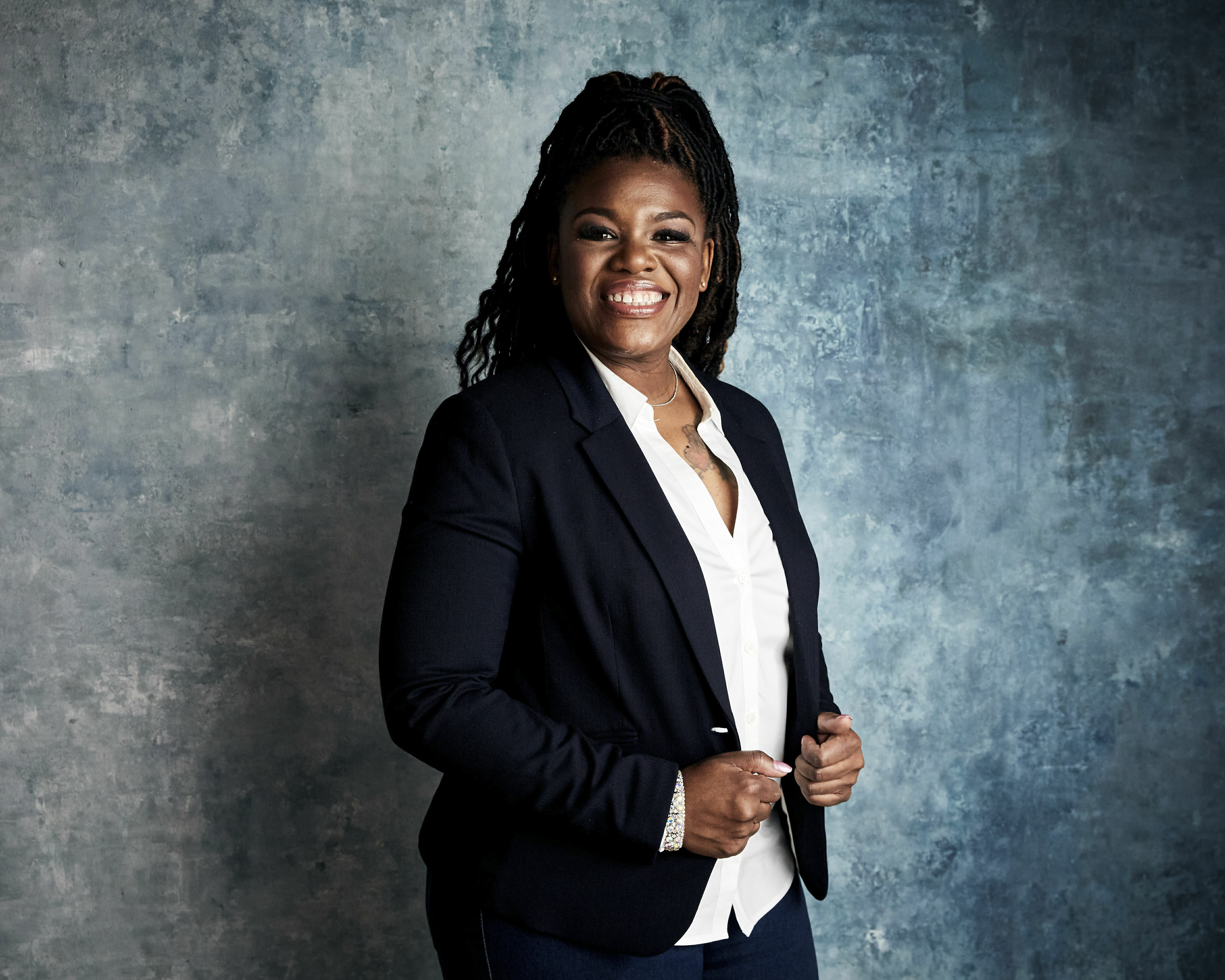 """FILE - In this Jan. 27, 2019, file photo Cori Bush poses for a portrait to promote the film """"Knock Down the House"""" at the Salesforce Music Lodge during the Sundance Film Festival in Park City, Utah. Bush, a onetime homeless woman who led protests following a white police officer's fatal shooting of a Black 18-year-old in Ferguson, Mo., ousted longtime Rep. William Lacy Clay Tuesday in Missouri's Democratic primary, ending a political dynasty that has spanned more than a half-century. Bush's victory came in a rematch of 2018, when she failed to capitalize on a national Democratic wave that favored political newcomers such as Bush's friend, Rep. Alexandria Ocasio-Cortez. (Photo by Taylor Jewell/Invision/AP, File)"""