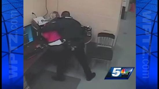 RAW VIDEO: Woman with knife, police officers struggle
