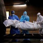 Global coronavirus deaths hit 900,000 as cases surge in India