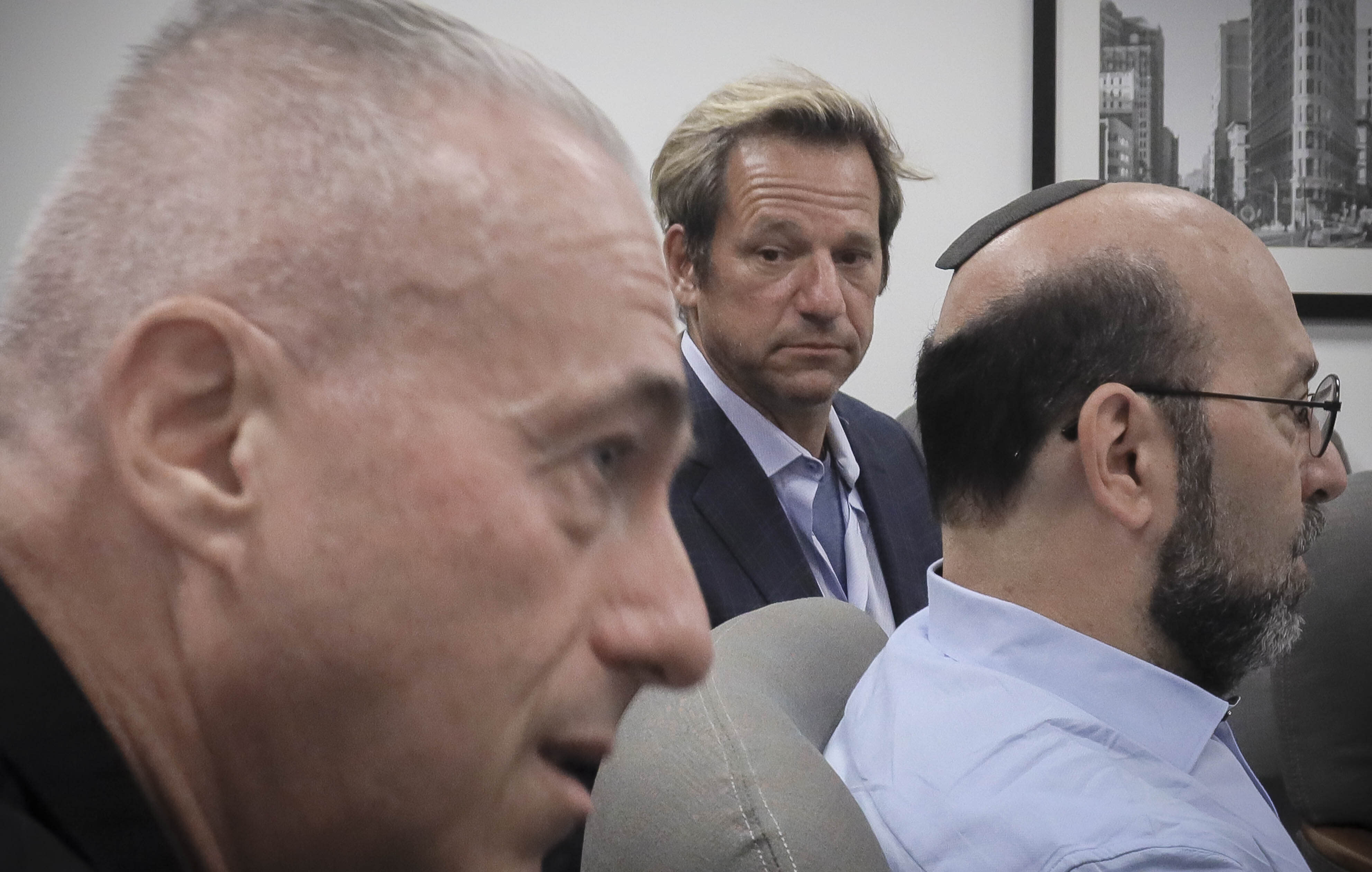 Barry Singer, left, David Bressler, center, and Jay Goldberg, right, who say they were sexually abused while they were students at Marsha Stern Talmudical Academy (MTA)—also known as Yeshiva University High School for Boys in Manhattan, hold a press conference, Thursday Aug. 22, 2019, in New York. They are among 38 former students in a lawsuit alleging sexual abuse by two rabbis: George Finkelstein, a long-time MTA principal, and Macy Gordon, a long-time MTA Judaic Studies teacher. (AP Photo/Bebeto Matthews)