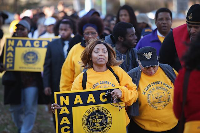 Members of the NAACP and their supporters arrive at the Michael Brown memorial to start a Journey for Justice, a seven-day 120-mile march from the memorial to the governor's mansion in Jefferson City, Missouri, on Nov. 29, 2014, in Ferguson, Missouri. (Scott Olson via Getty Images)