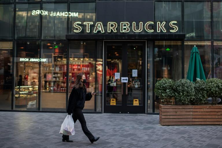 China, where a woman is pictured passing a Starbucks in Beijing, has the second most branches of the coffee chain worldwide, after the United States