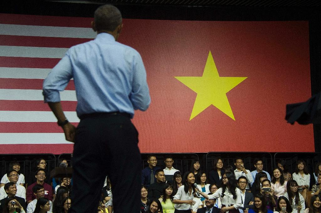 US President Barack Obama listens as a young female rapper sings a song at a town hall event in Ho Chi Minh City (AFP Photo/Jim Watson)