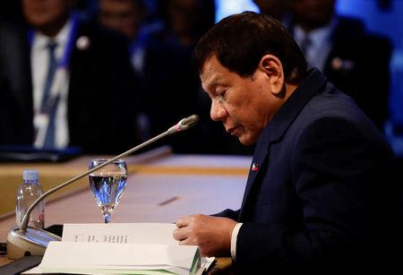 Philippine President Rodrigo Duterte participates in the opening session of the 15th ASEAN-India Summit at the Philippine International Convention Center in Manila