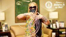 Woman with world's longest fingernails cuts them short for the first time in almost 30 years