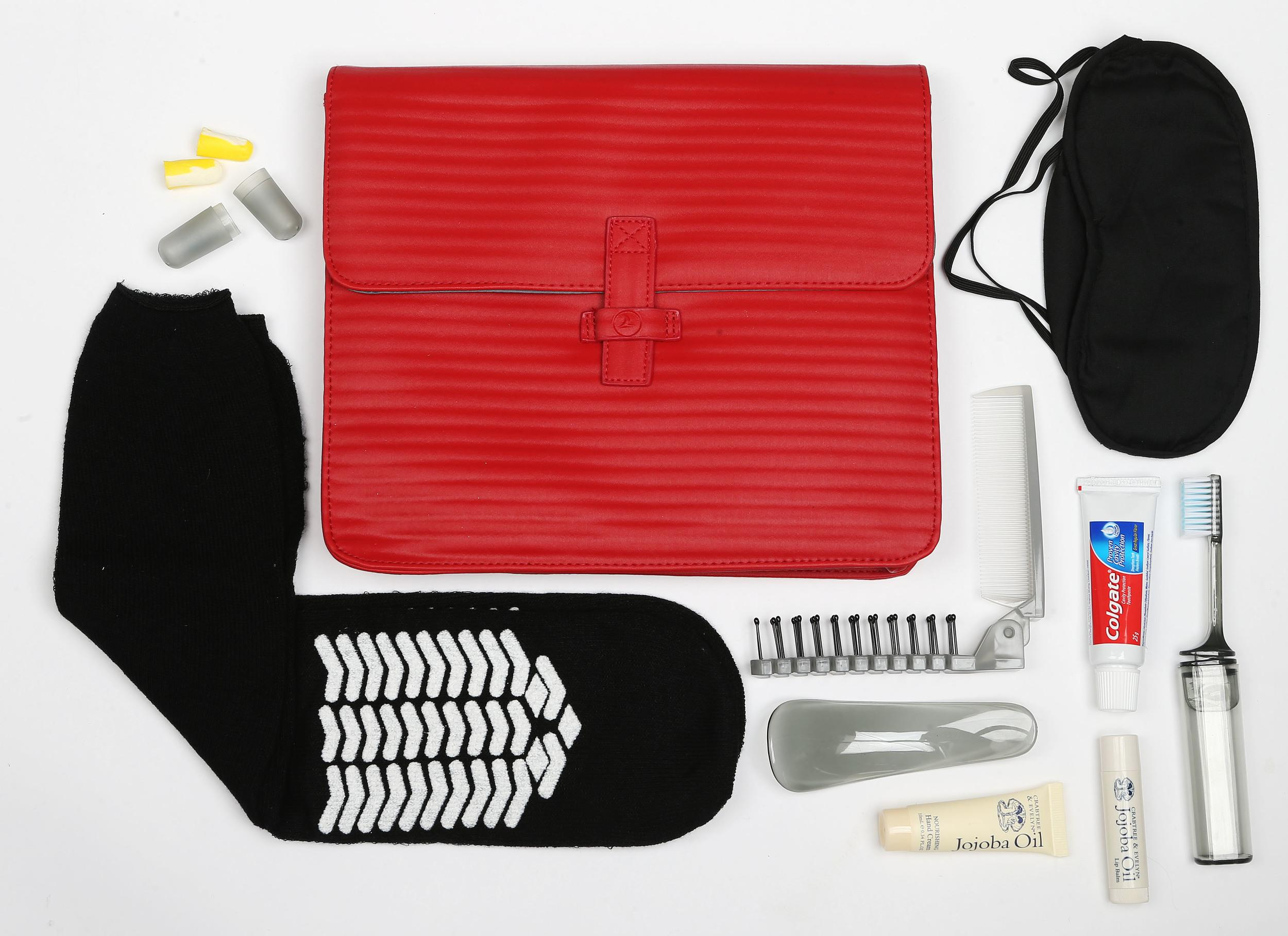 """<p><strong>What do you get?</strong> Turkish Airlines' Business-Class offering exudes style: Non-slip socks, eye mask, stickers – """"Please do not disturb"""" and """"Please wake me for meal"""", Crabtree & Evelyn Jojoba Oil nourishing hand cream and lip balm, foldable brush/comb, toothbrush, toothpaste, ear plugs, shoe horn<br /> <strong>Best bit of the kit?</strong> The bag. It's a bright letterbox-red envelope of a bag.</p>"""