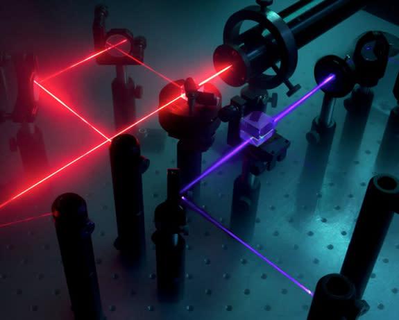 New Computer Bridges Classical and Quantum Computing