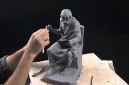 Plato shown holding an iPad in a creative clay sculpture (video)