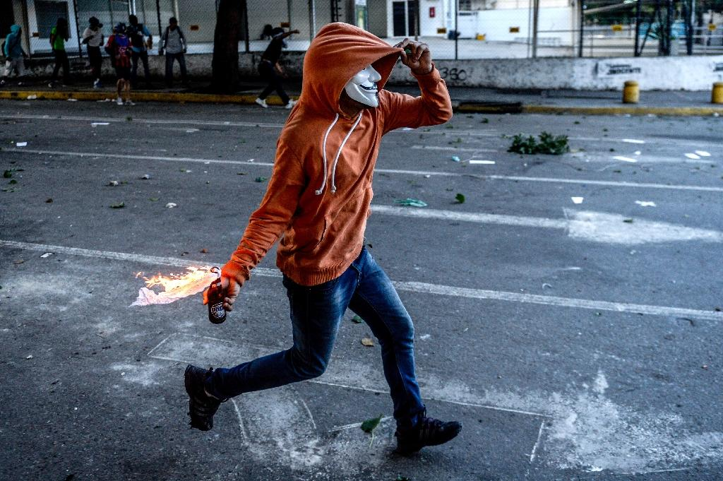 Clashes in the streets of Venezuela have become commonplace, and at least five people died during the two-day strike (AFP Photo/FEDERICO PARRA)