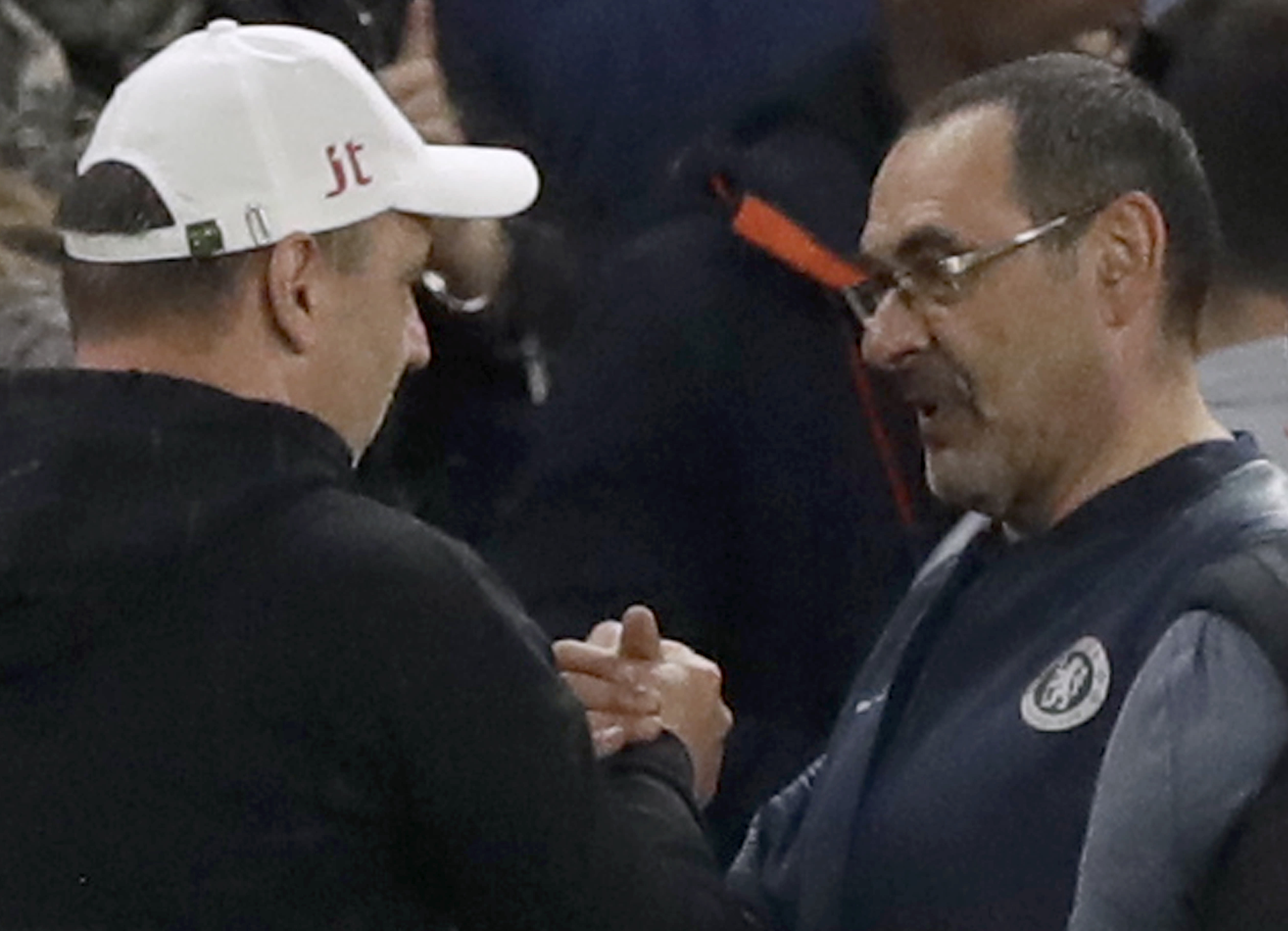 Slavia's coach Jindrich Trpisovsky, left, greets Chelsea head coach Maurizio Sarri, right, after the Europa League quarterfinal, second leg, soccer match between Chelsea and Slavia Prague at Stamford Bridge stadium in London, Thursday, April 18, 2019. (AP Photo/Matt Dunham)