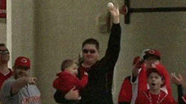 Dad catches home run ball while holding baby