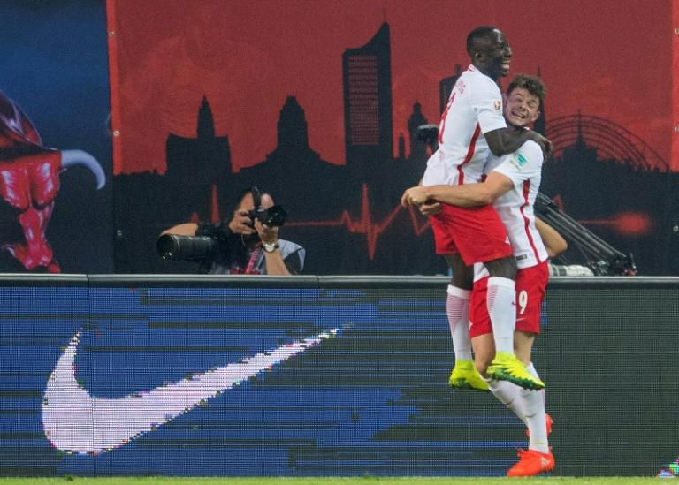 Naby Keita (L) celebrates scoring RB Leipzig's winning goal against Dortmund in only their second Bundesliga match.