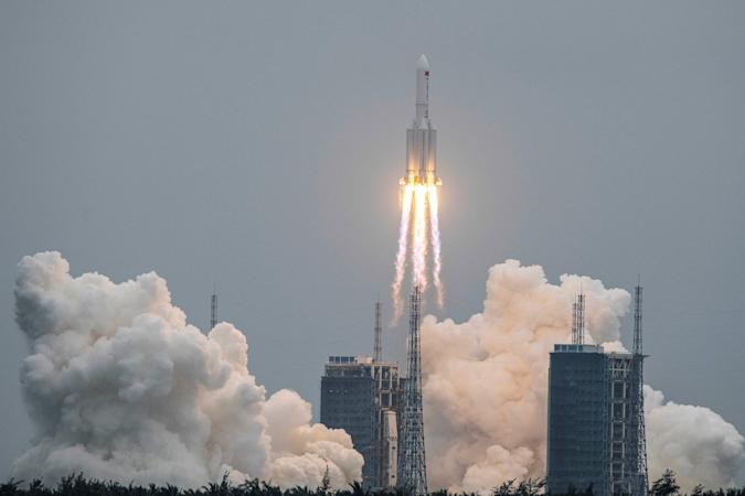 A Long March 5B rocket, carrying China's Tianhe space station core module, lifts off from the Wenchang Space Launch Center in southern China's Hainan province on April 29, 2021. - China OUT (Photo by STR / AFP) / China OUT (Photo by STR/AFP via Getty Images)