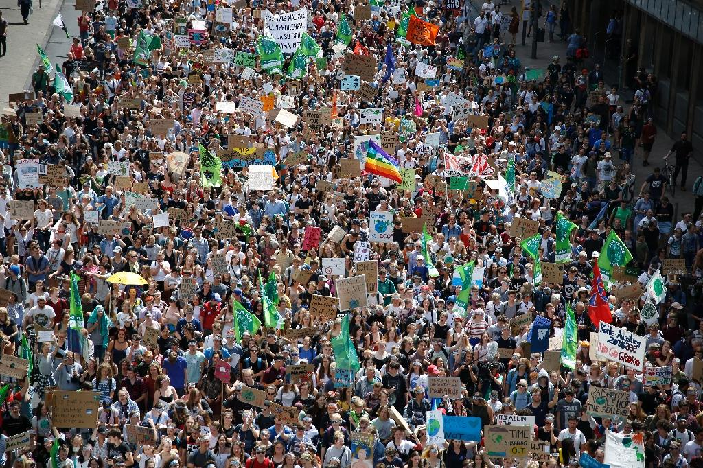 """Young climate activists hold their biggest """"Fridays for Future"""" demonstration yet, in Aachen, western Germany (AFP Photo/LEON KUEGELER)"""