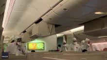 Authorities in Hazmat Suits Check Passengers From Hong Kong for Coronavirus at Milan Airport