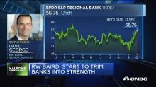 RW Baird cuts regional banks to sell