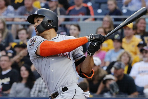Giancarlo Stanton will defend his Home Run Derby title. (AP Photo)
