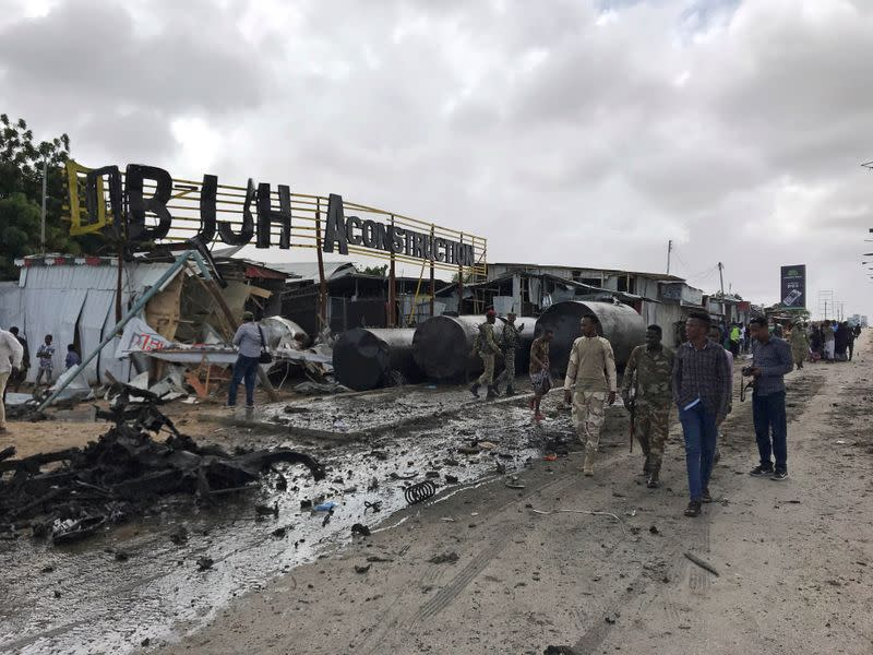 Somali security officers are seen at the scene of an explosion in Mogadishu
