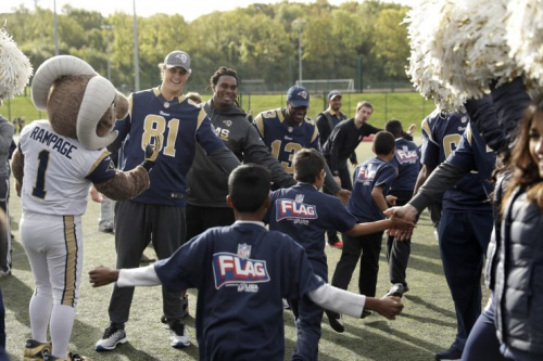 Members of the Rams, including their mascot, rubbed elbows with London-area children. (AP)