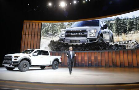 Joe Hinrichs, Executive VP and President, The Americas for Ford, introduces the 2017 Ford F-150 Raptor pickup truck at the North American International Auto Show in Detroit, January 11, 2016. REUTERS/Mark Blinch