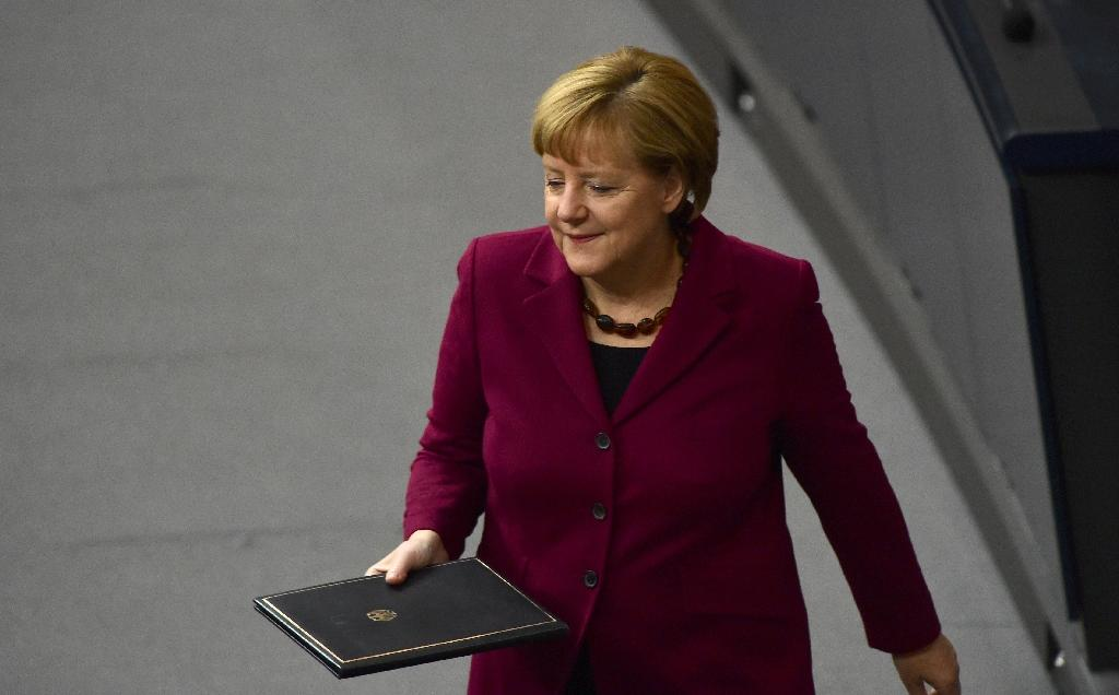 German Chancellor Angela Merkel arrives to give a speech on the refugee crisis in parliament, ahead of an EU summit on October 15, 2015 in Berlin (AFP Photo/John MacDougall)