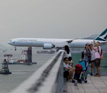 Lone Analyst Who Cut Cathay to Sell Says He Faces Huge Pressure