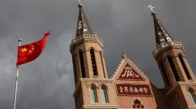 Insight: In China's Catholic heartland, Vatican deal brings Communist Party closer